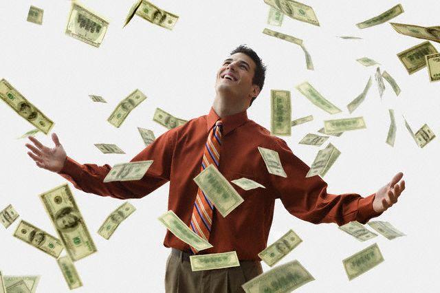 Money Falling on Happy Businessman --- Image by JLP/Jose L. Pelaez/Corbis